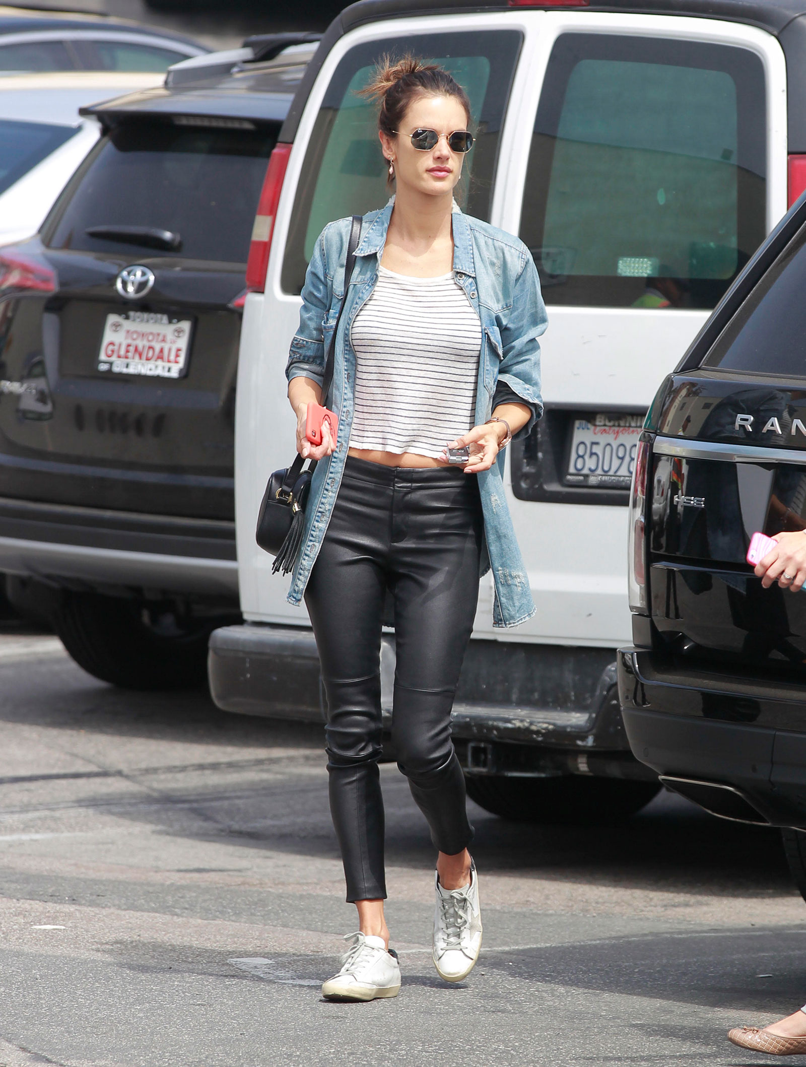 Alessandra Ambrosio's denim shirt and leather leggings look for less