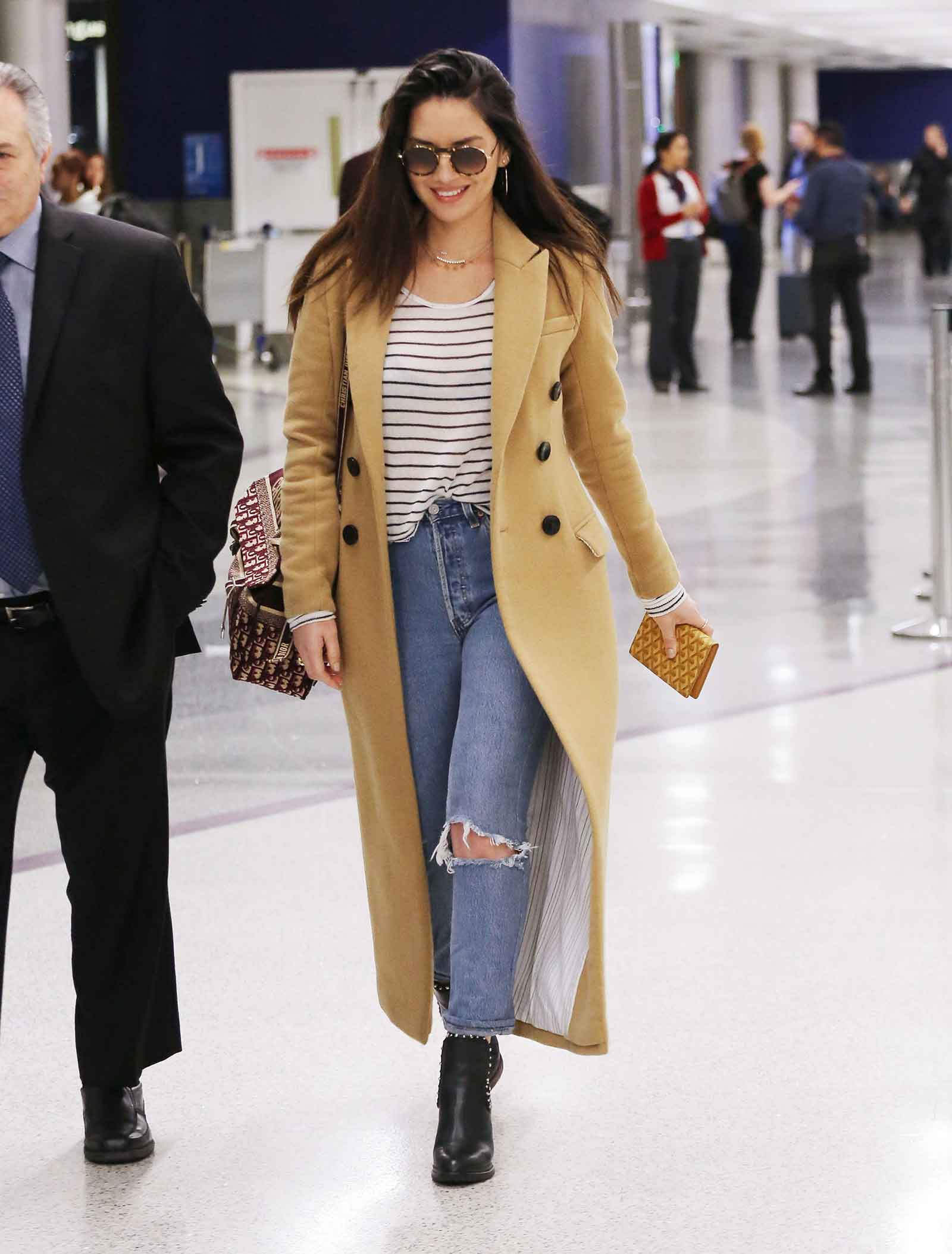 Olivia Munn's camel coat and striped tee, perfect everyday outfit!