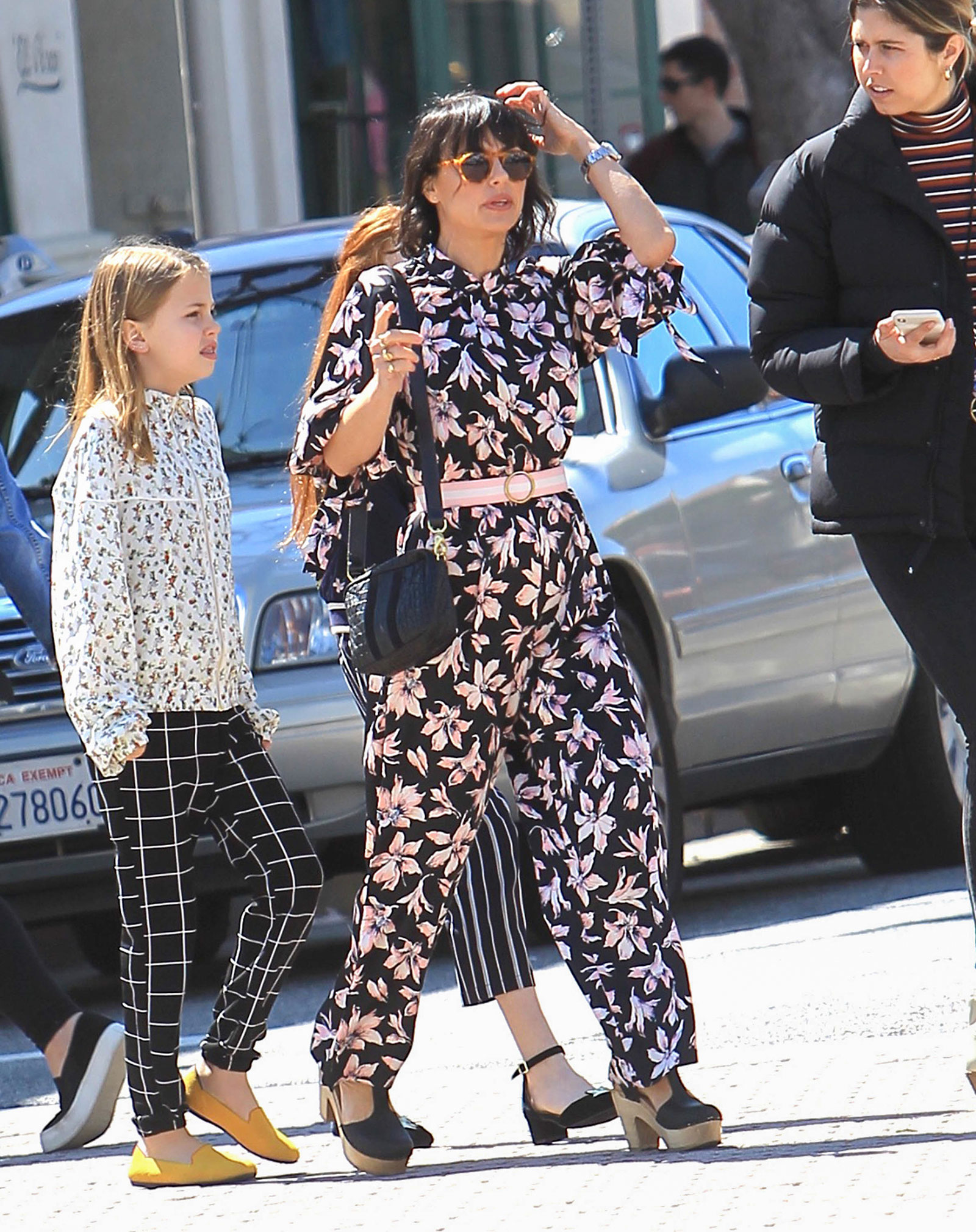 Constance Zimmer's floral jumpsuit and clogs look for less