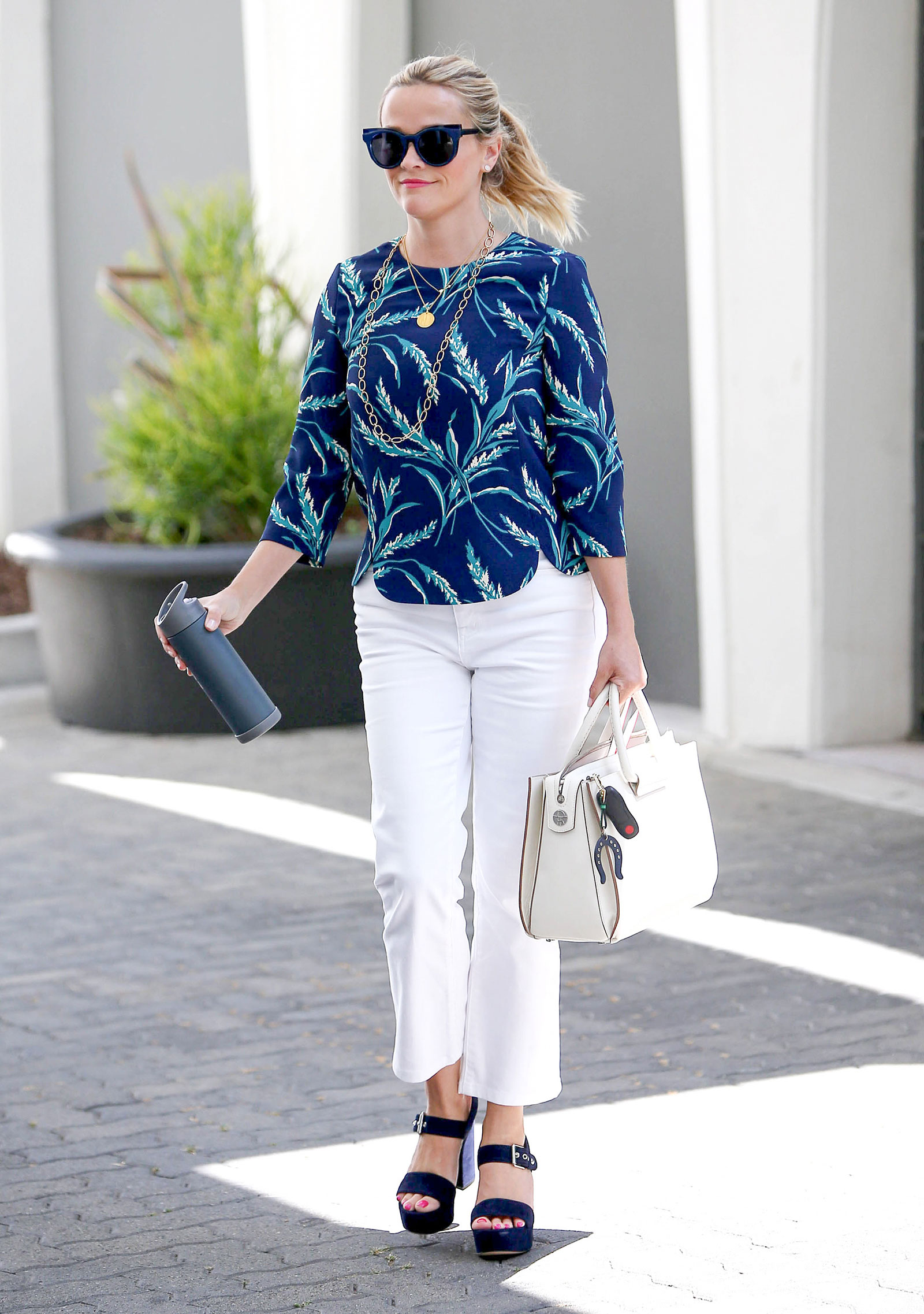 Reese Witherspoon's Floral Top, White Pants and Platform Sandals Look for Less