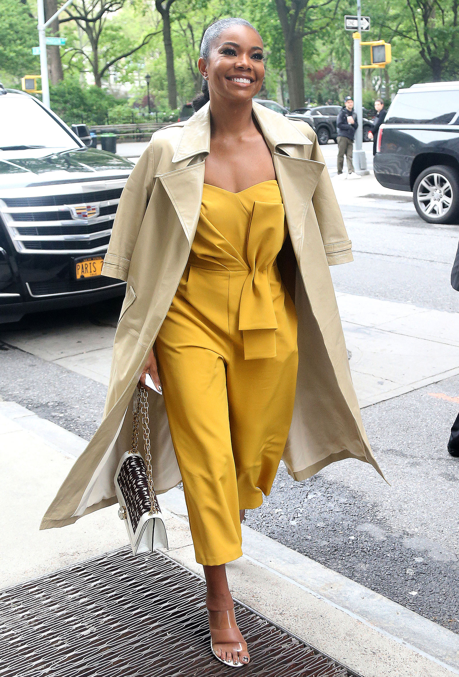 Gabrielle Union's yellow jumpsuit and clear sandals look for less