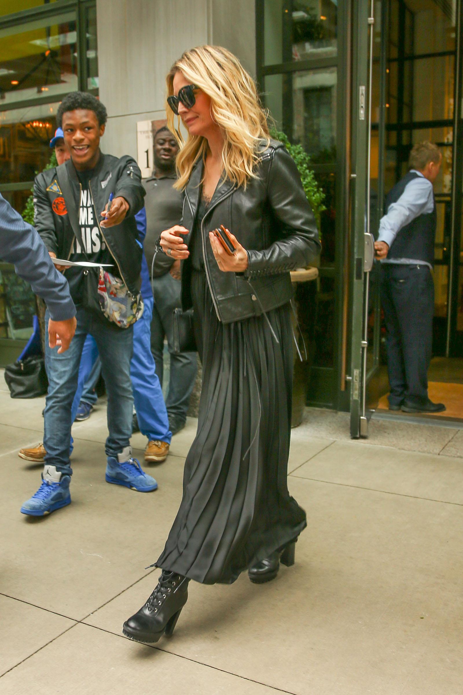 Michelle Pfeiffer looks sexy in all black leather jacket, laci cami tank, pleated maxi skirt, and heeled combat boots!