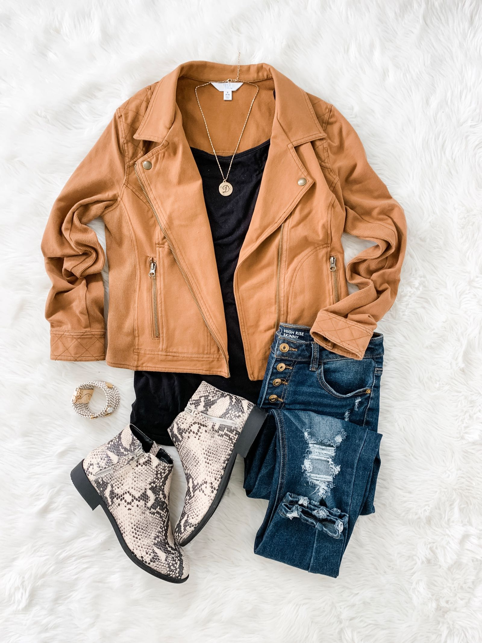 Moto jacket outfit idea for fall featuring camel jacket, black top and snake print booties