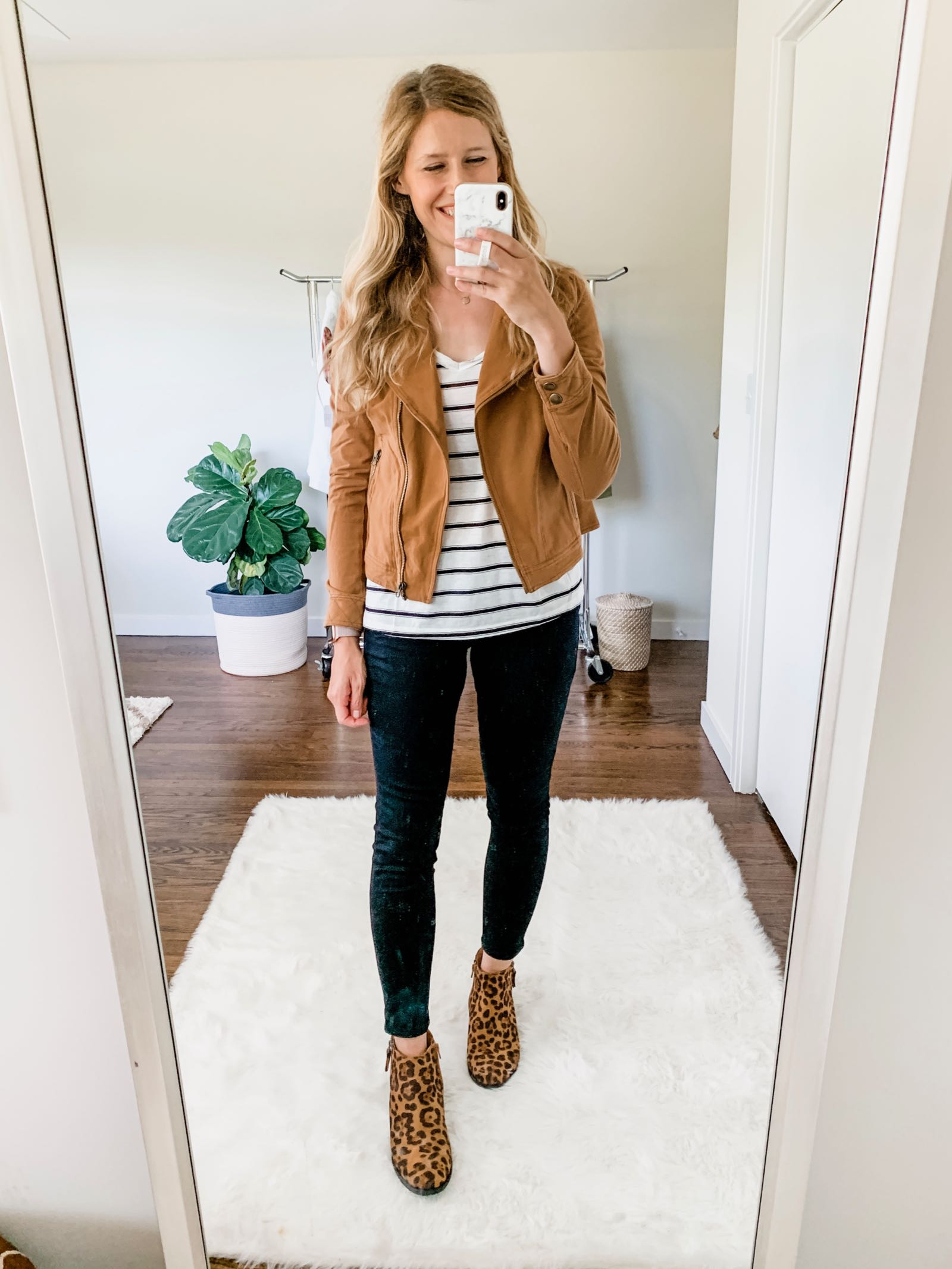 Moto jacket outfit idea for fall featuring camel jacket, striped top and leopard print booties