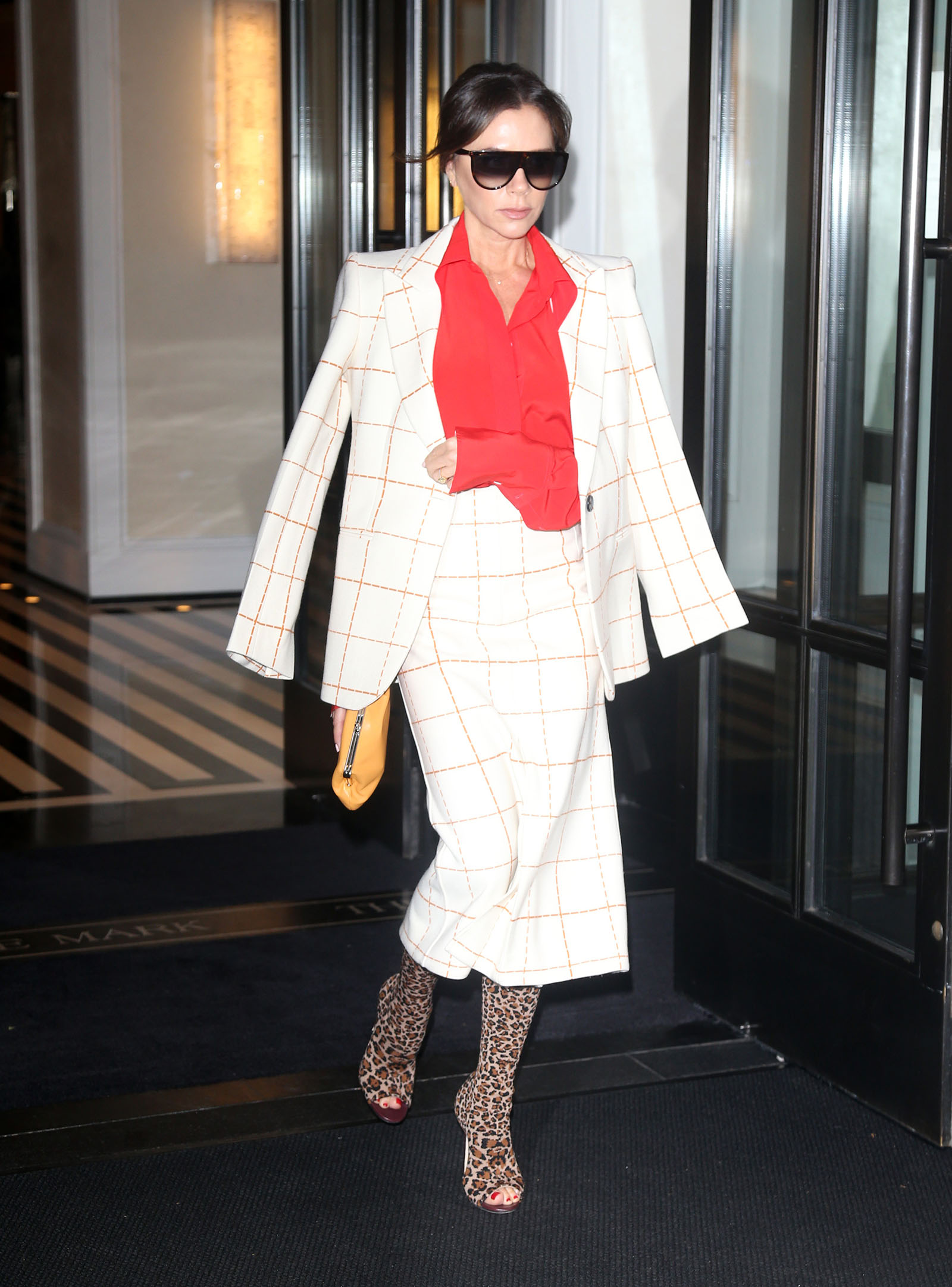 Victoria Beckham steps out in a fun and sophisticated skirt suit.