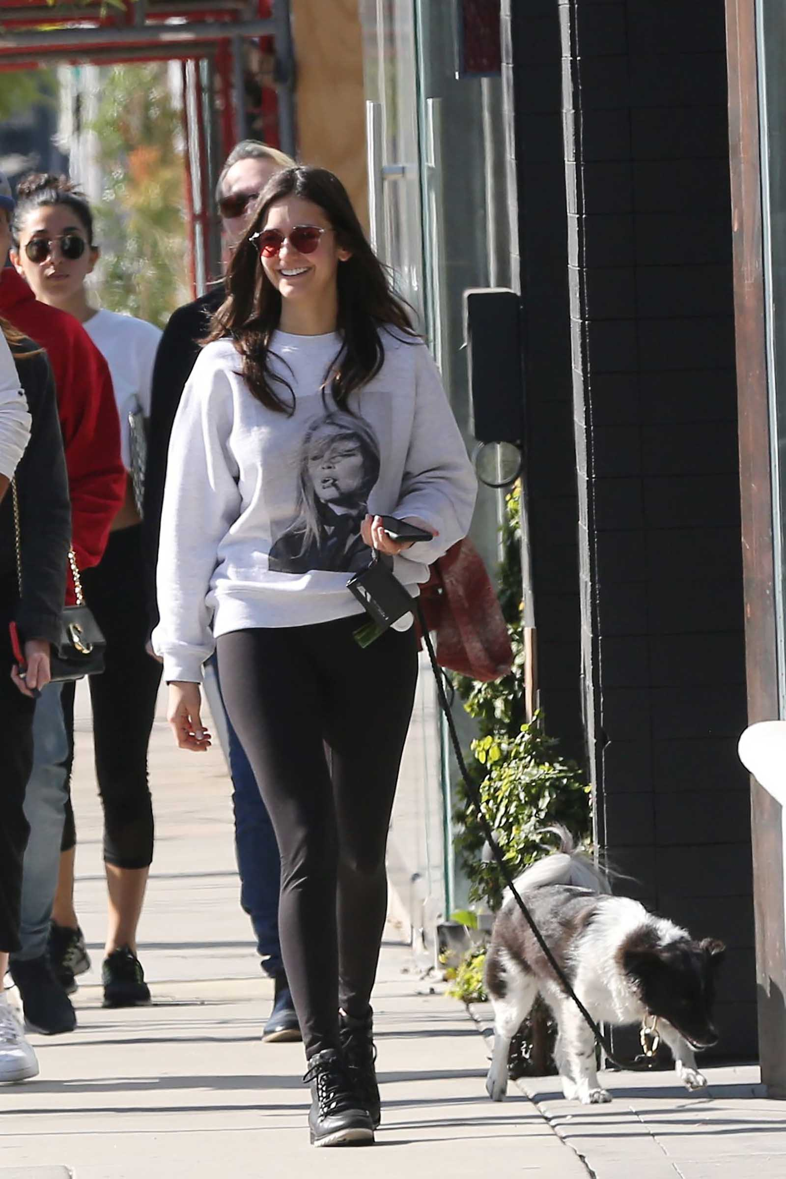 Nina Dobrev is cool girl perfection in a graphic sweatshirt