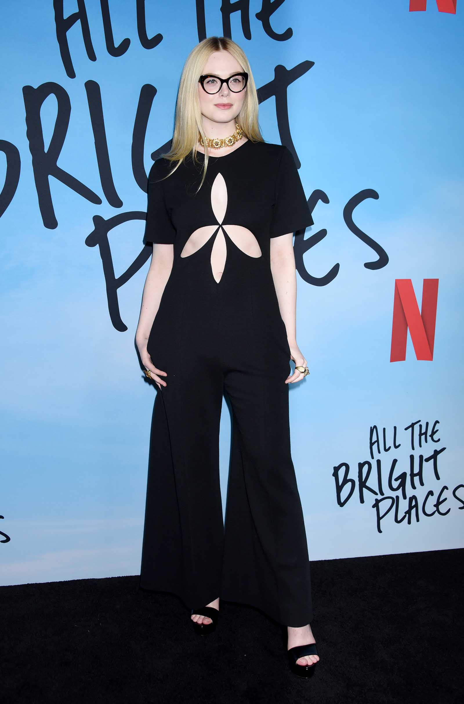 Elle Fanning is chic in a cutout detail jumpsuit.