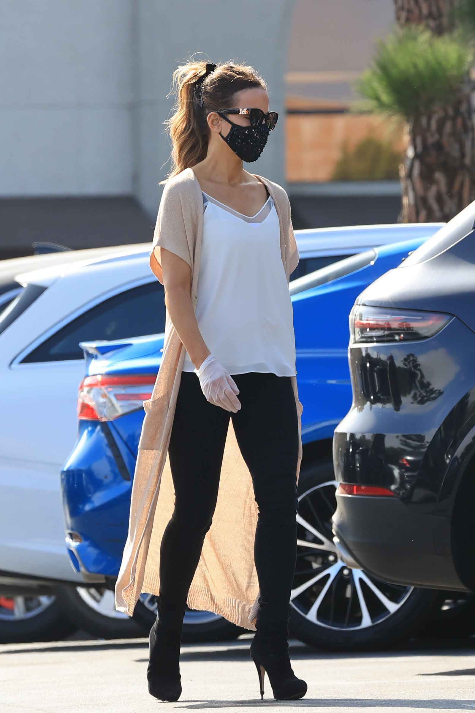 Kate Beckinsale's long cardigan, sequin face mask and stiletto ankle booties look for less