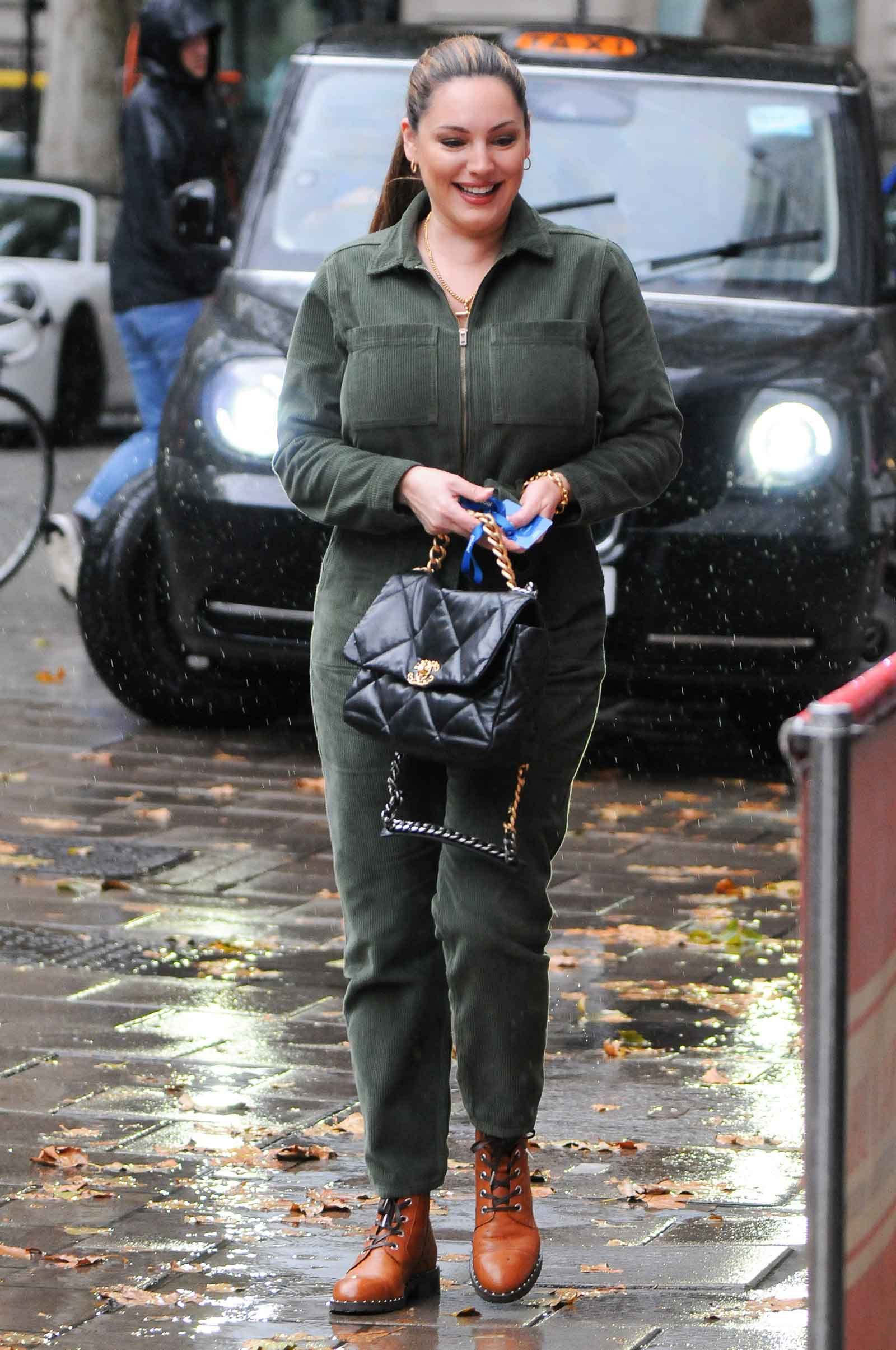 Kelly Brook's boiler suit and combat boots