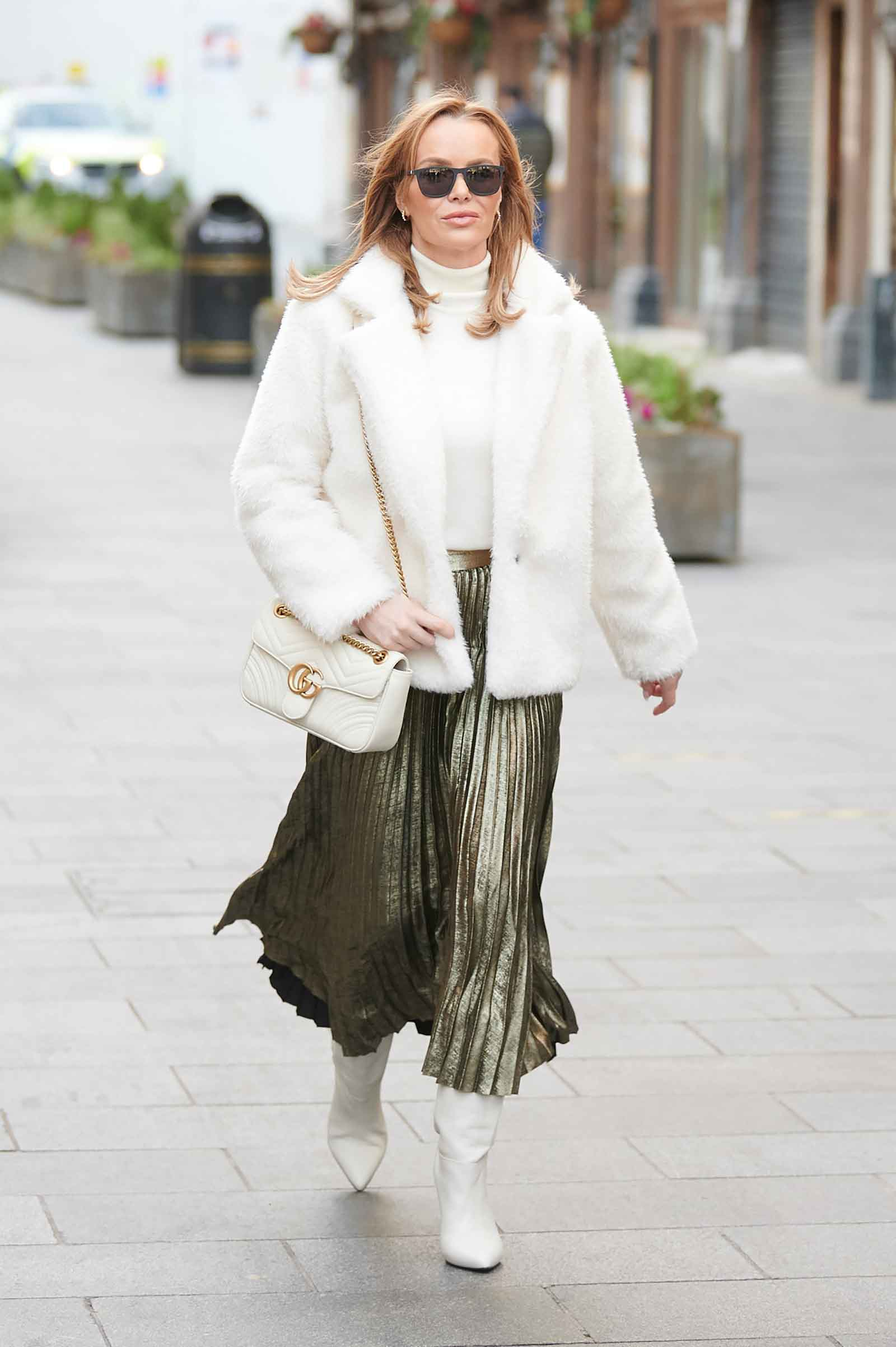 Amanda Holden's Gold Pleated Skirt and White Fur Jacket Look for Less | Holiday Outfit Idea