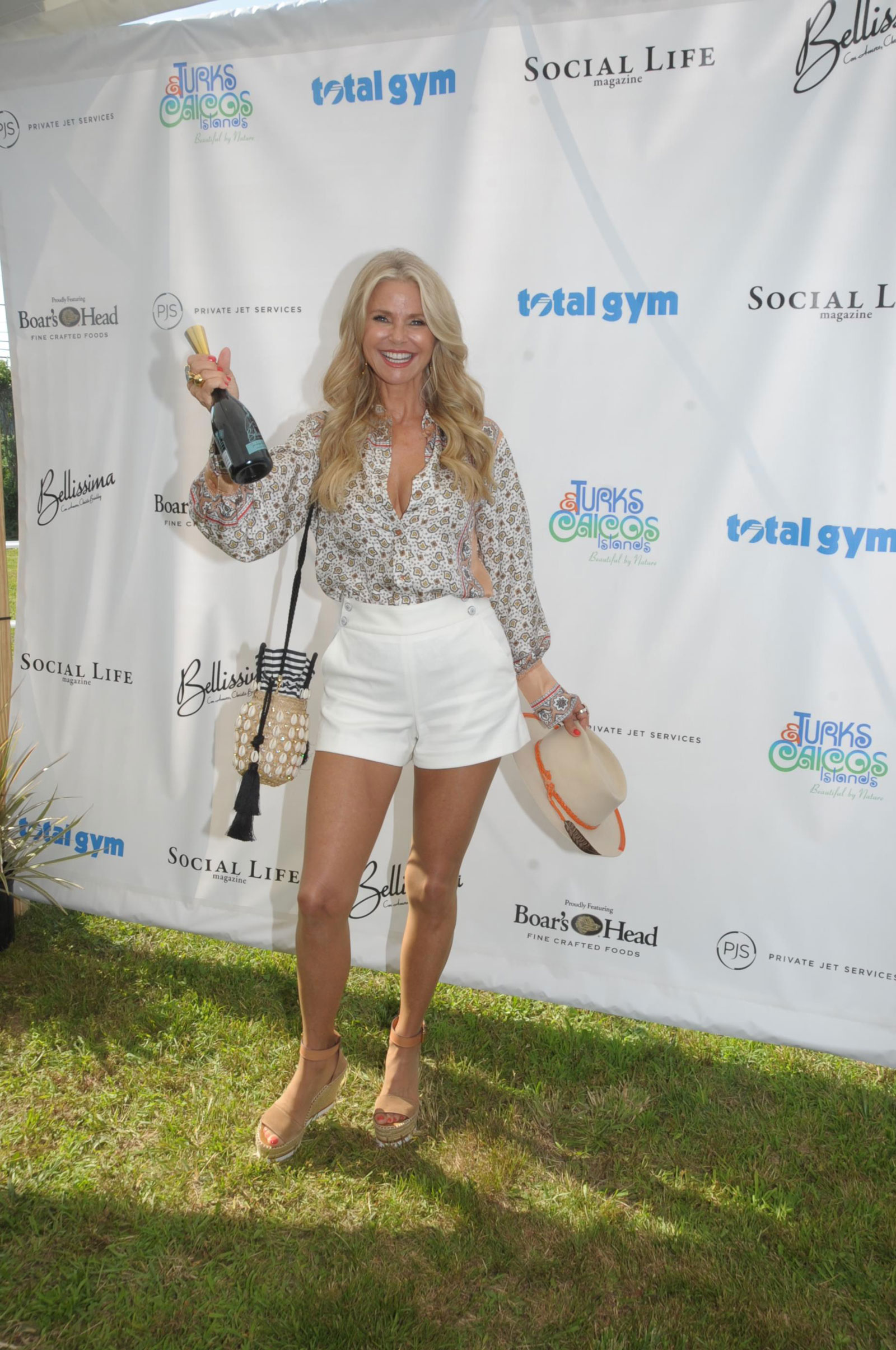 Christie Brinkley's Printed Blouse and White Shorts