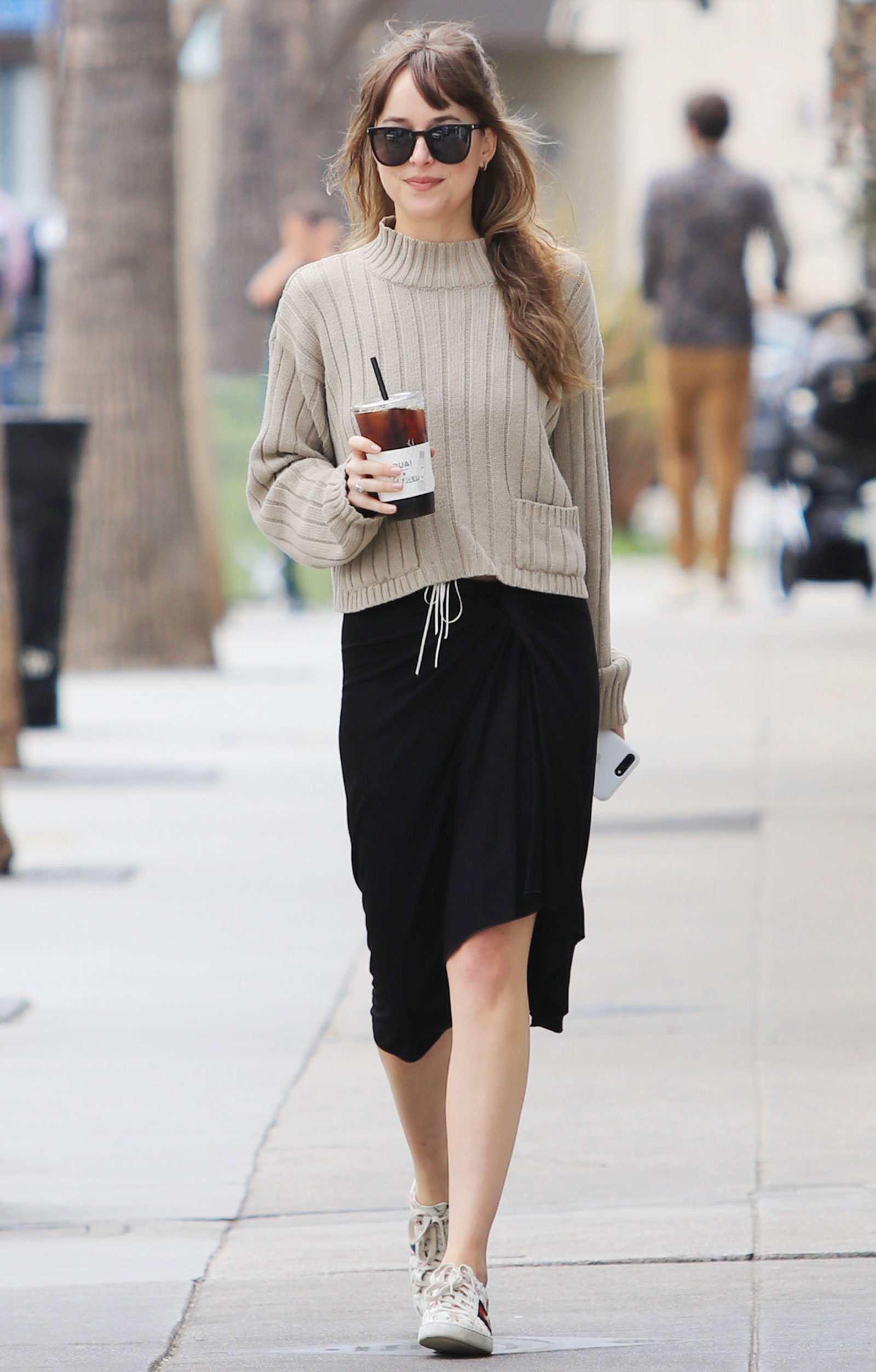 372620282 Dakota Johnson's Mock Neck Sweater and Gucci Floral Sneakers Look ...