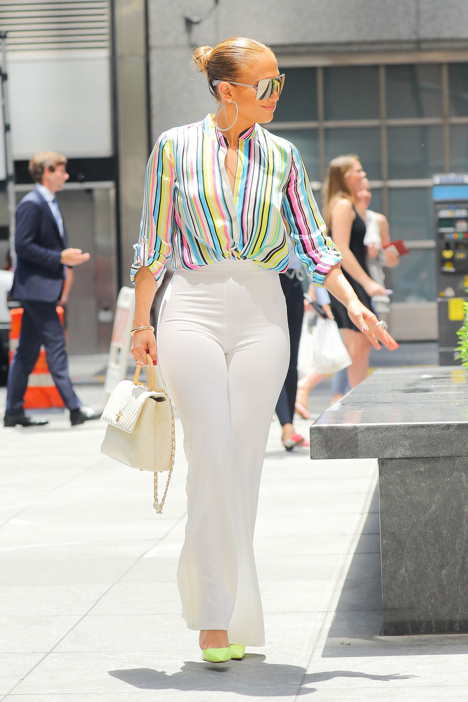 Jennifer Lopez Rainbow Stripe Top and White Flare Pants