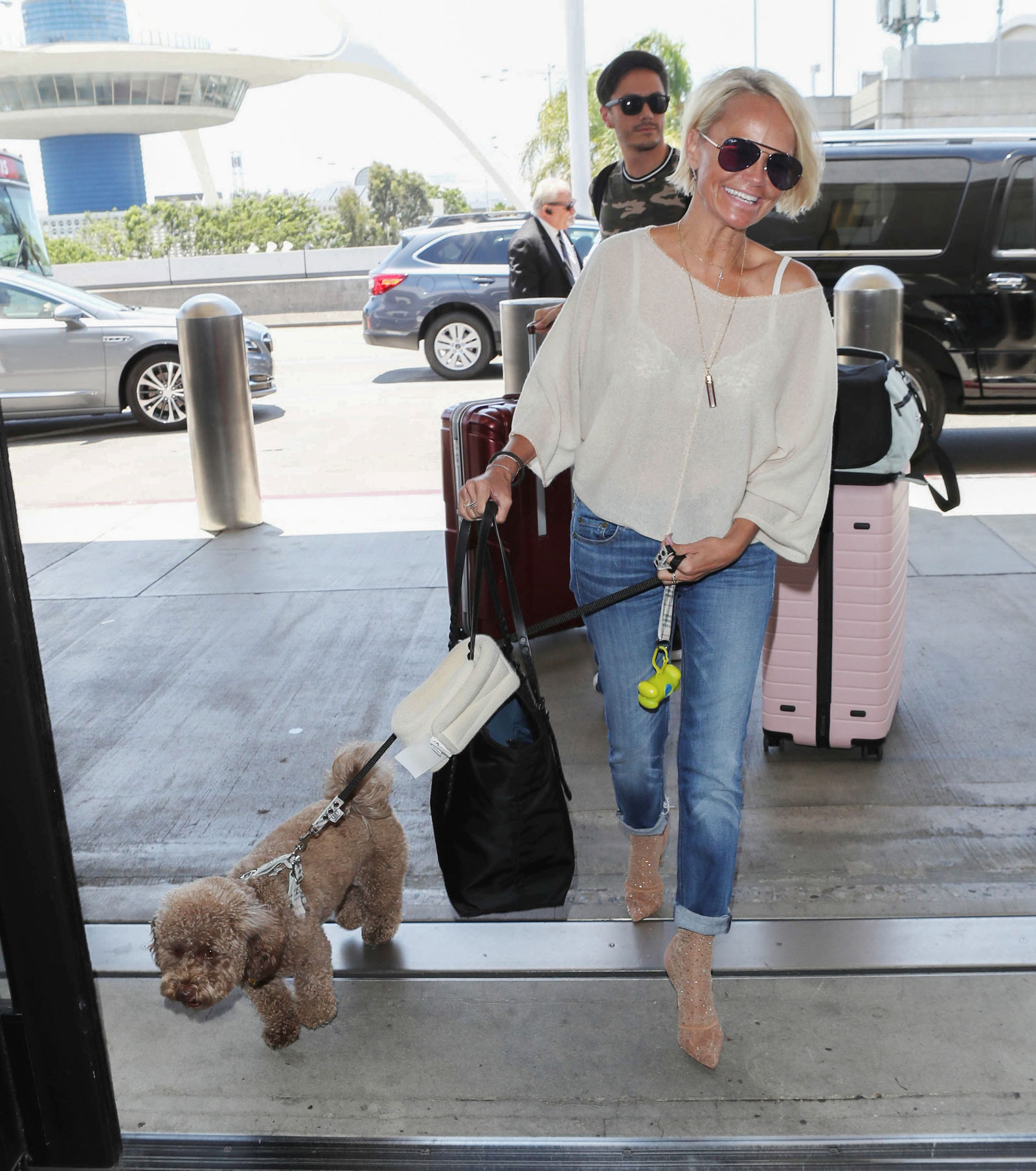 Kristin Chenoweth Travel Outfit and Pink Suitcase