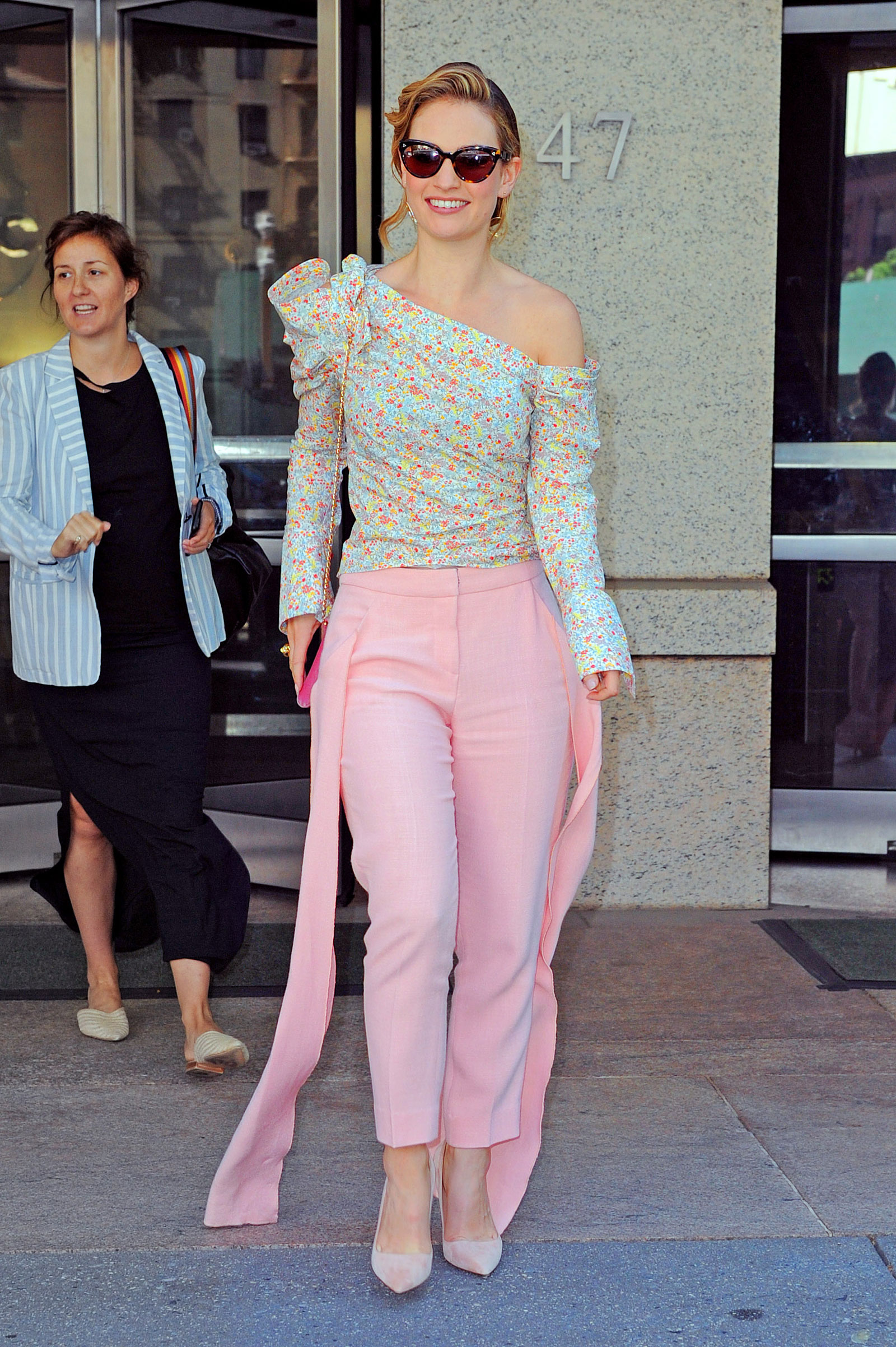 Lily James Floral One Shoulder Top and Pink Trousers