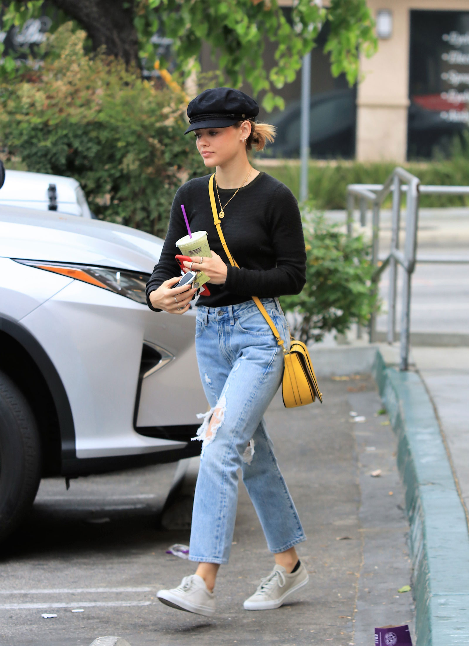 Lucy Hale Louise et Cie Bag and Destroyed Denim