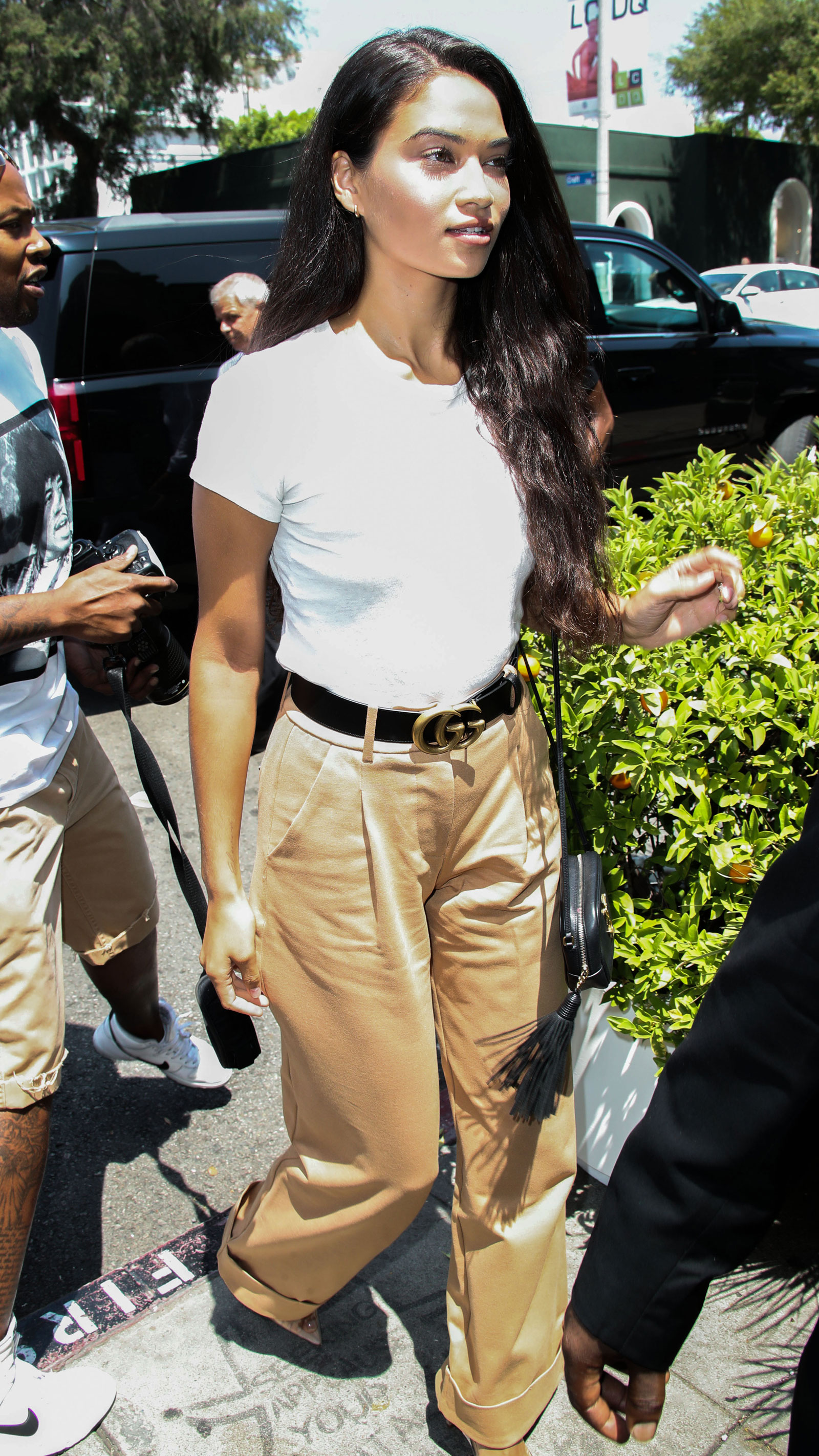 Shanina Shaik Wide Leg Pants and Gucci Belt